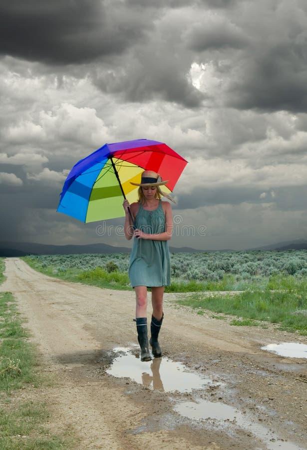 Girl & rainbow umbrella royalty free stock photos
