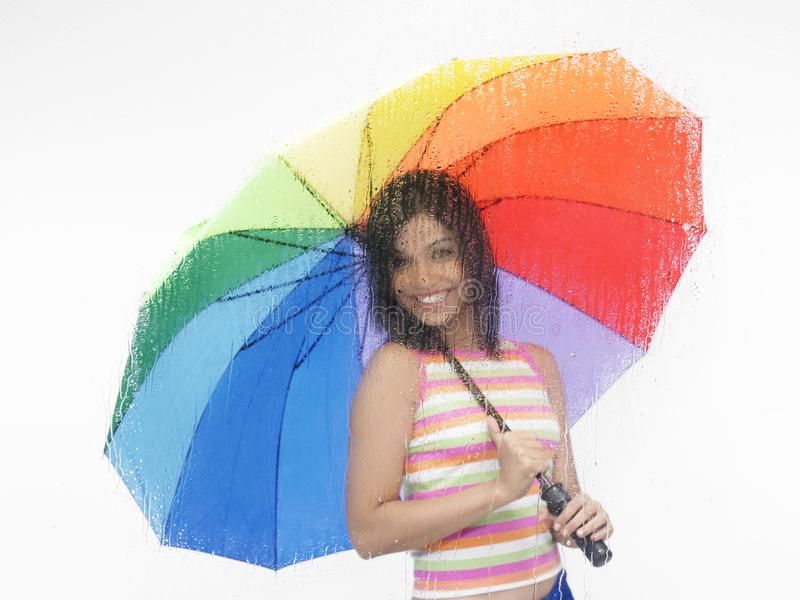 Download Girl with rainbow umbrella stock photo. Image of fingers - 6818582