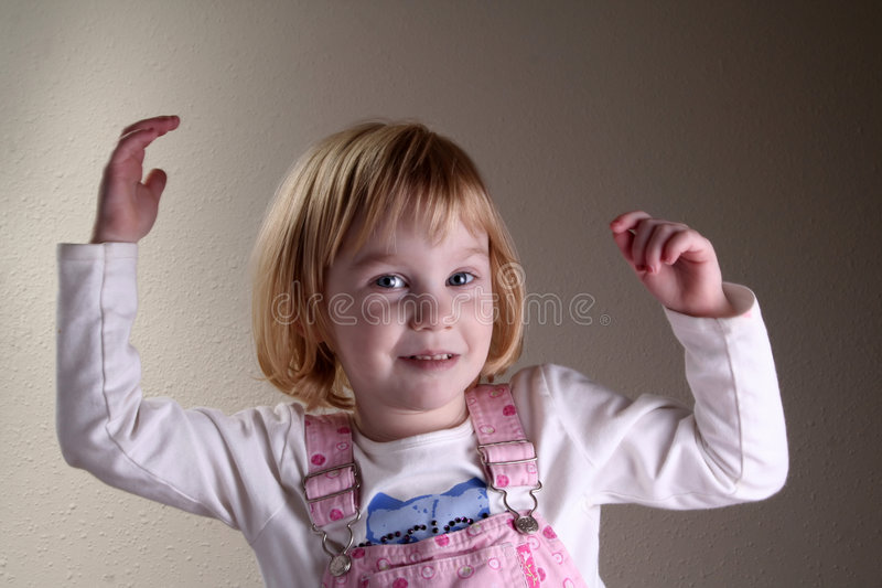 Girl With Raised Hands Stock Images