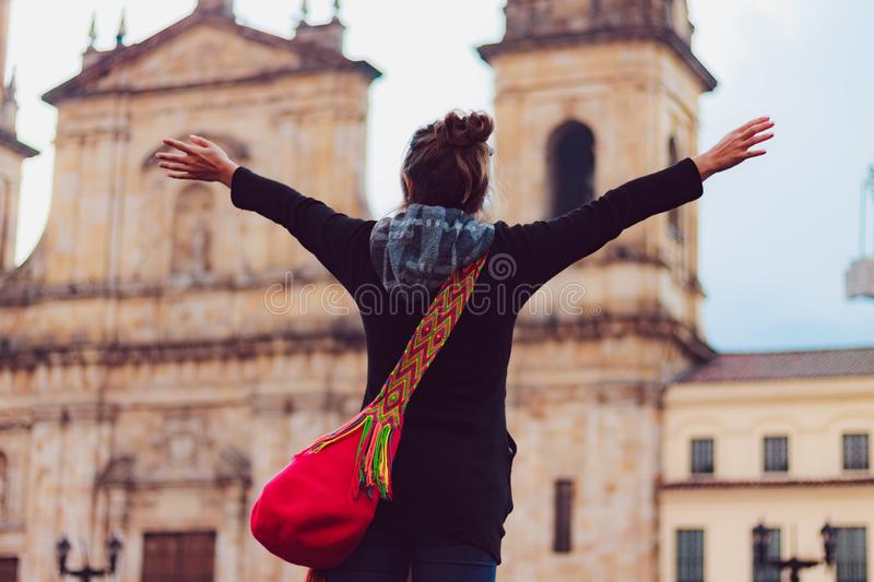 Woman on vacation in Bogota Colombia. Girl with raised hands happy on vacation in Bogota Colombia royalty free stock photography