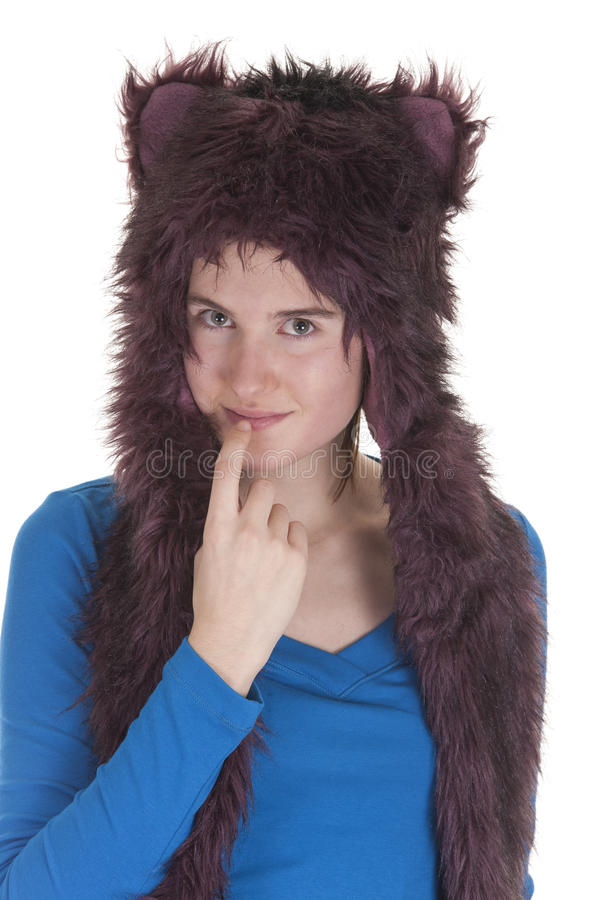 Girl with rave hat. Girl wearing plush rave hat on white background royalty free stock image