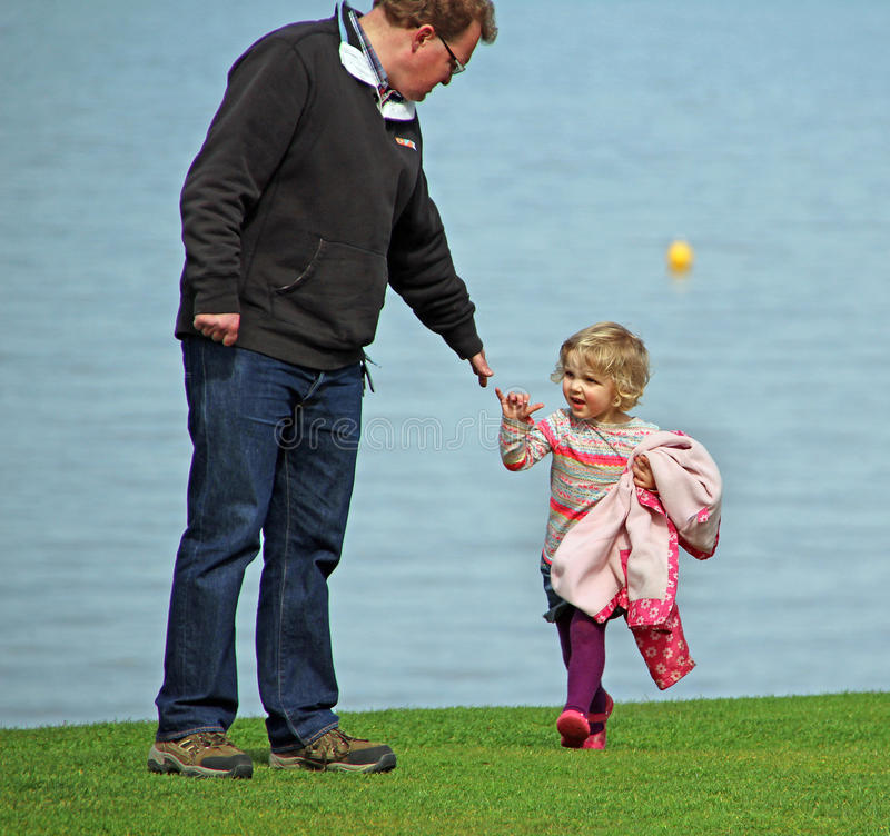 Girl reaching out for daddies hand royalty free stock photos