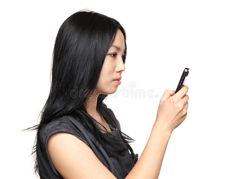 Girl read sms on phone. Over white background royalty free stock photos