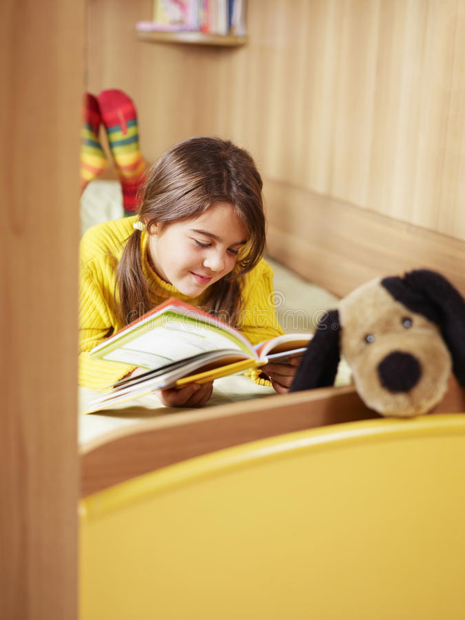Download Girl reading book stock image. Image of laying, indoor - 11914091
