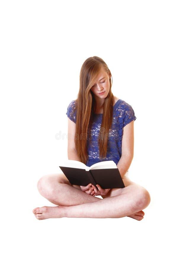 Girl reading book. stock photos
