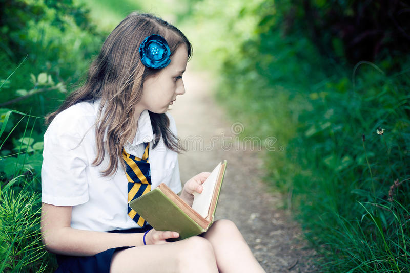 Girl reading a book stock image