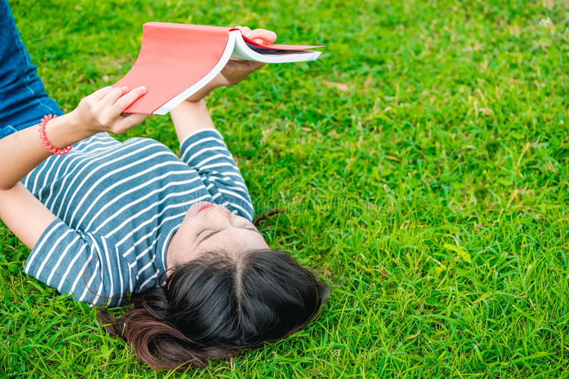 Girl reading the book. stock photo