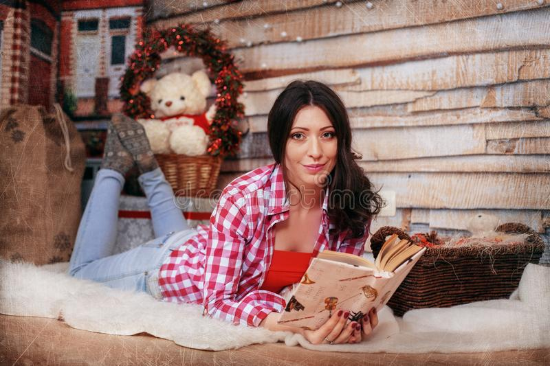 Girl reading a book. The concept of the New Year and Merry Chris royalty free stock photography