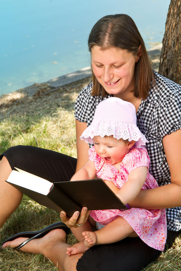 Download Girl Reading Book With Her Mother Stock Image - Image: 25648637