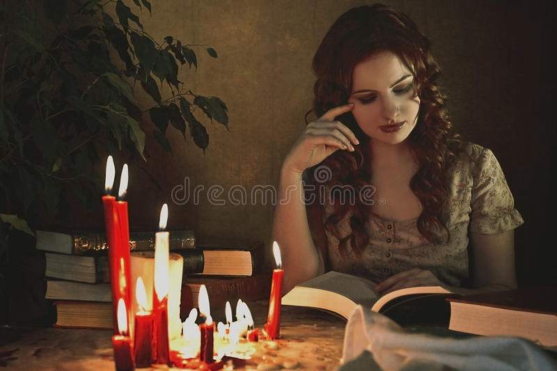 Girl reading a book royalty free stock photo