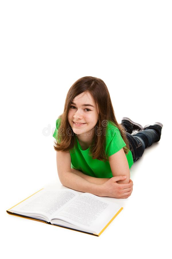 Girl reading book on white background. Girl reading book isolated on white background royalty free stock photography