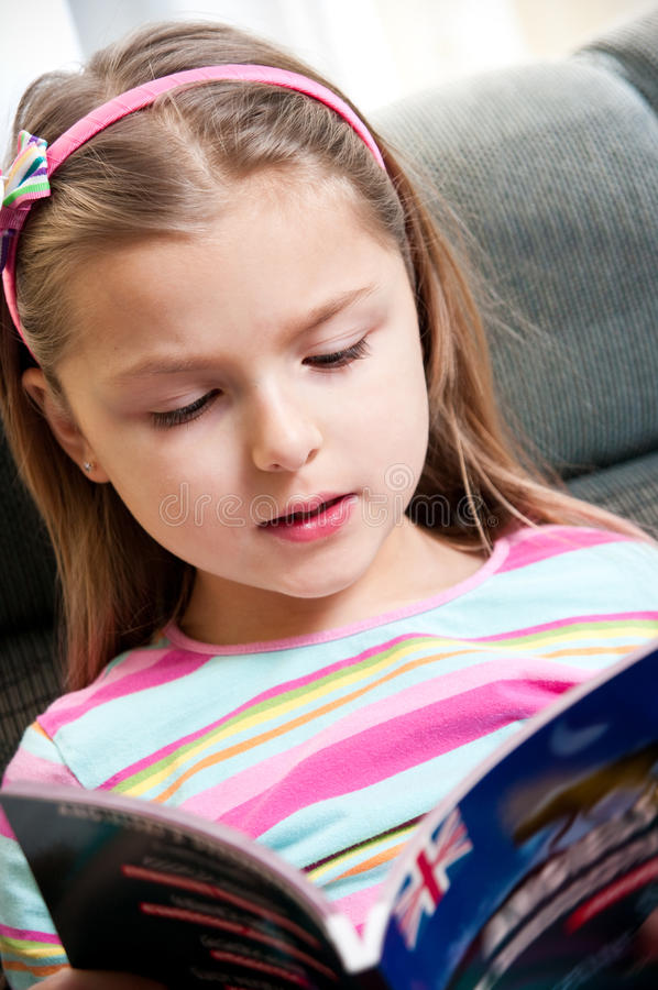 Girl reading English book royalty free stock photography