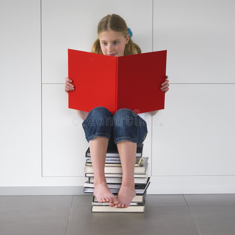 Girl reading an exciting book royalty free stock photography