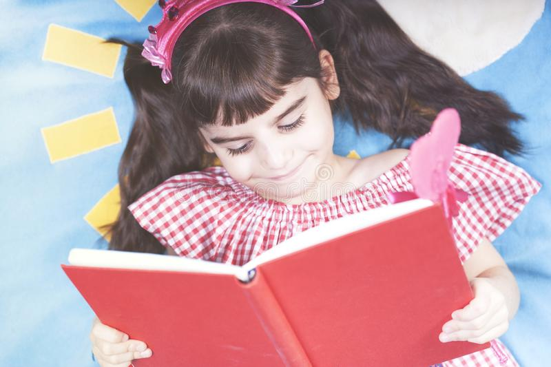 Girl reading at home royalty free stock image