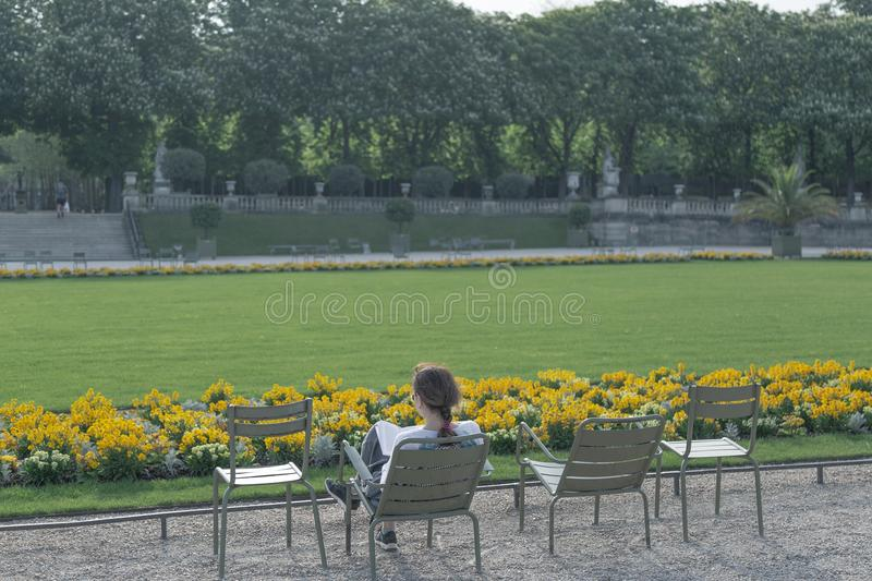Girl reading in the Luxembourg Garden royalty free stock images