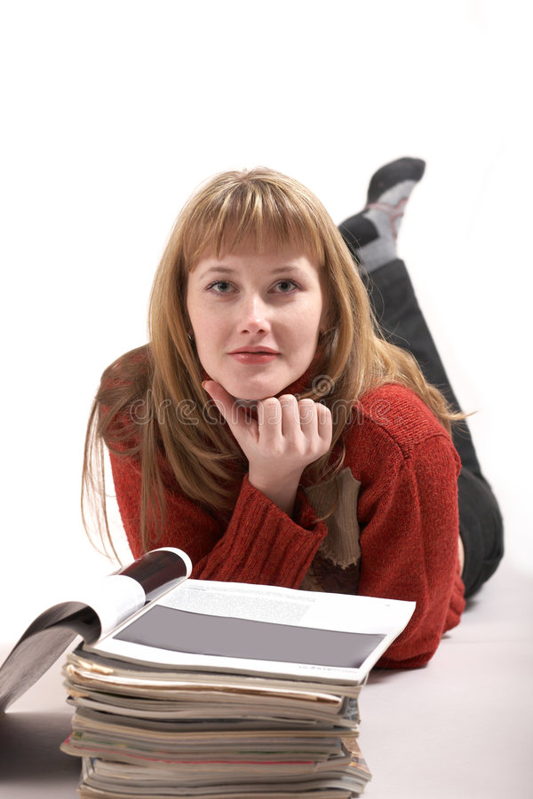 A girl reading magazines stock photography