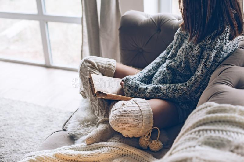 Girl reading and relaxing on a couch stock images