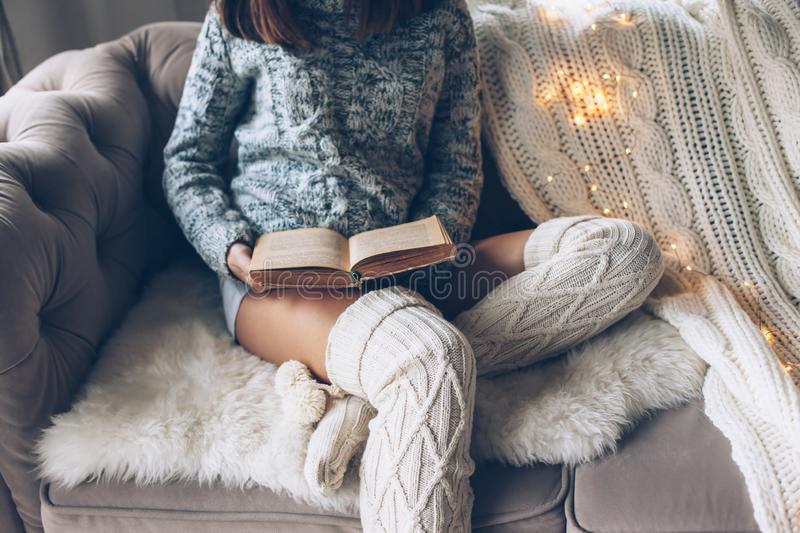 Girl reading and relaxing on a couch royalty free stock photo