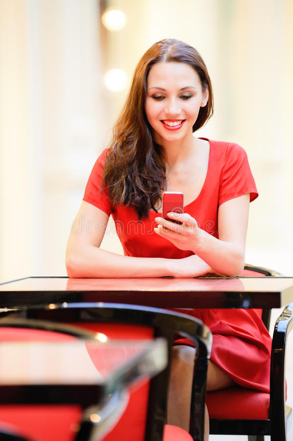 Girl reads sms on phone royalty free stock photography
