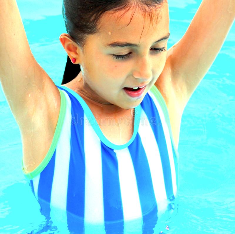 Girl Ready to Dive With Confidence of a Budding Athlete royalty free stock image