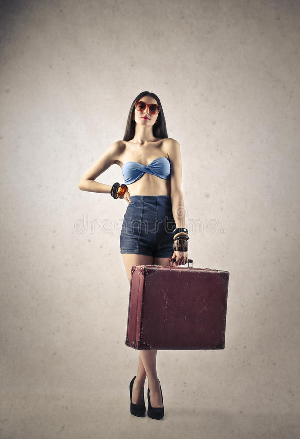Girl ready to go on vacation stock images