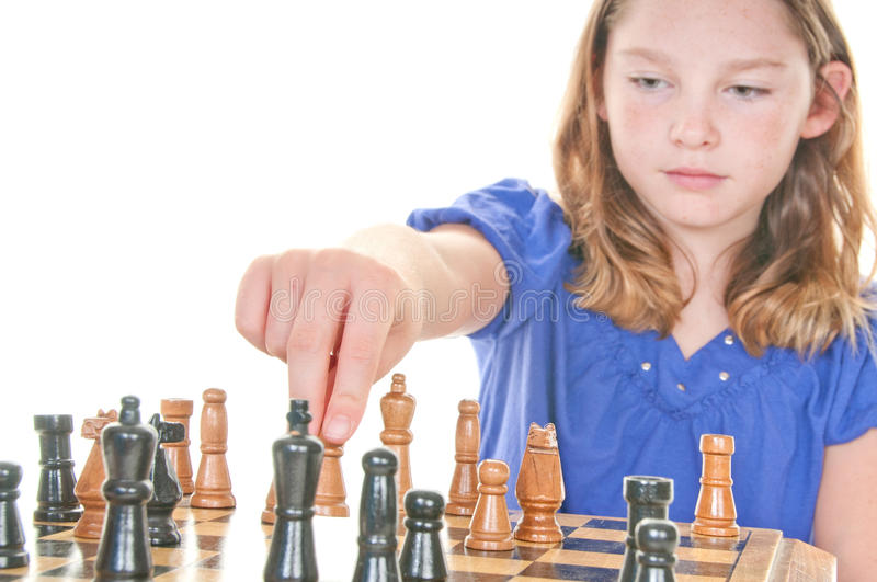 Girl ready to win in chess royalty free stock photography