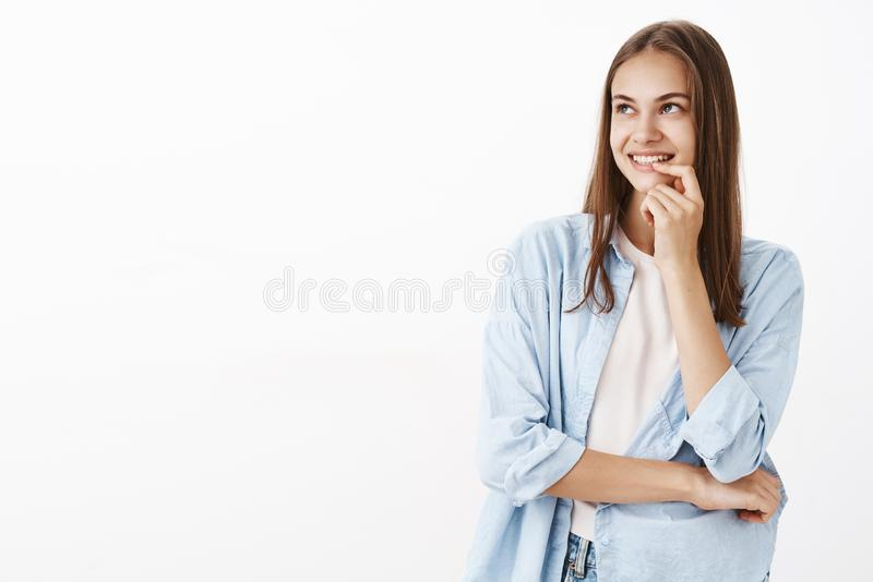 Girl recalling first kiss with boyfriend feeling nostalgic and flirty gazing at upper left corner with romantic royalty free stock image