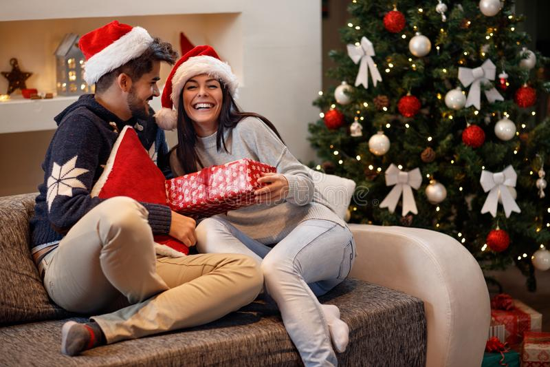 Girl receive present from boy for holiday. Girl receive present from boy for Christmas holiday royalty free stock photography