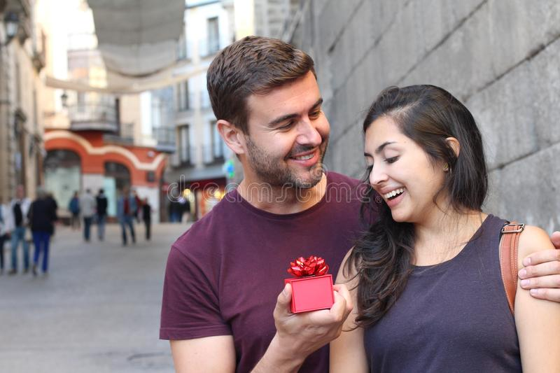 Girl receiving a surprise from his loved one stock photography