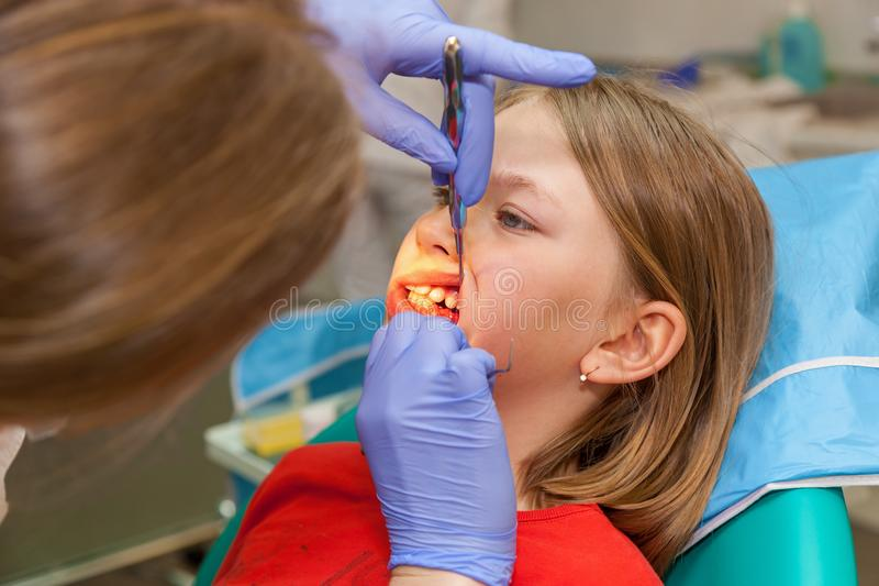 Girl on a reception for stomatology stock images