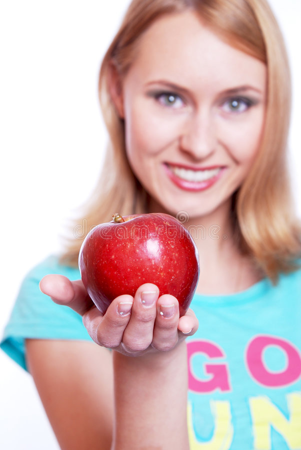 The girl with a red apple royalty free stock photography