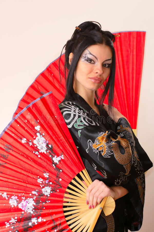 Girl with red asian fan stock photography