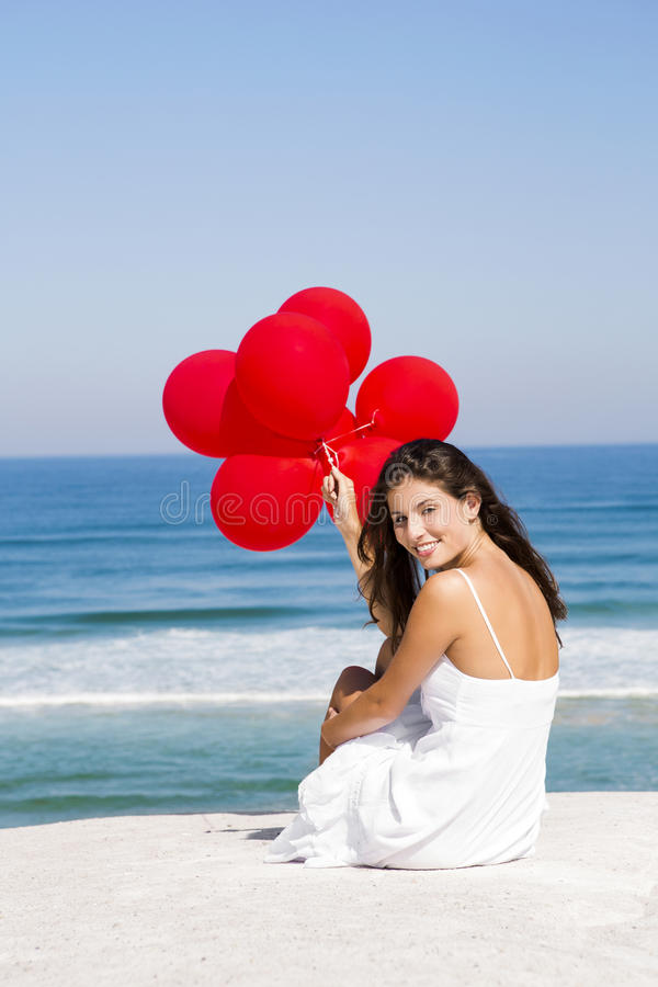 Girl With Red Ballons Stock Images