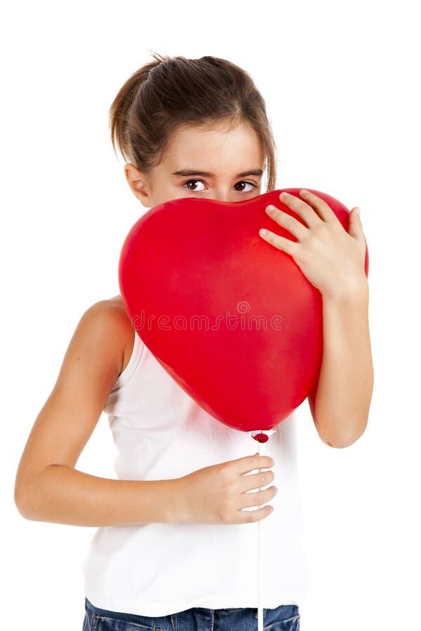 Girl with a red balloon stock photos