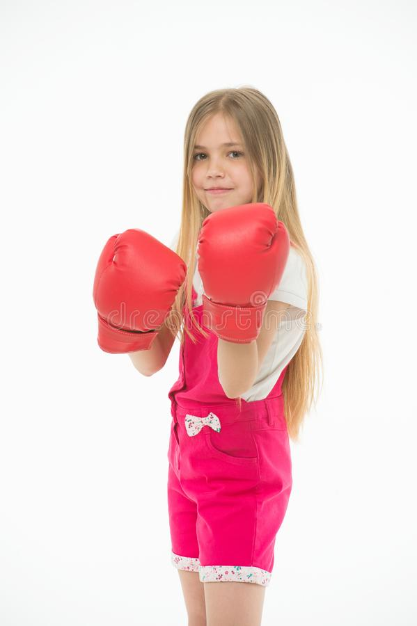 Girl in red boxing gloves, training strong spirit. Kid in pink jump suit isolated on white background. Child with. Serious face ready to fight. Self defense royalty free stock images