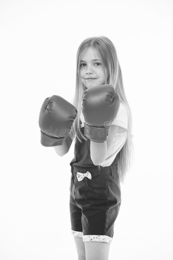 Girl in red boxing gloves, training strong spirit. Kid in pink jump suit isolated on white background. Child with. Serious face ready to fight. Self defense stock images