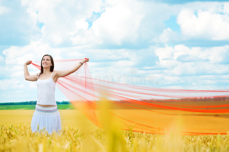 Girl With A Red Cloth Catches Wind In The Field Stock Photos