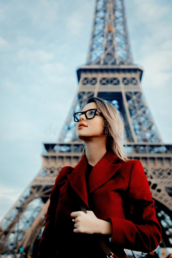 Girl in red coat and bag at parisian street stock images
