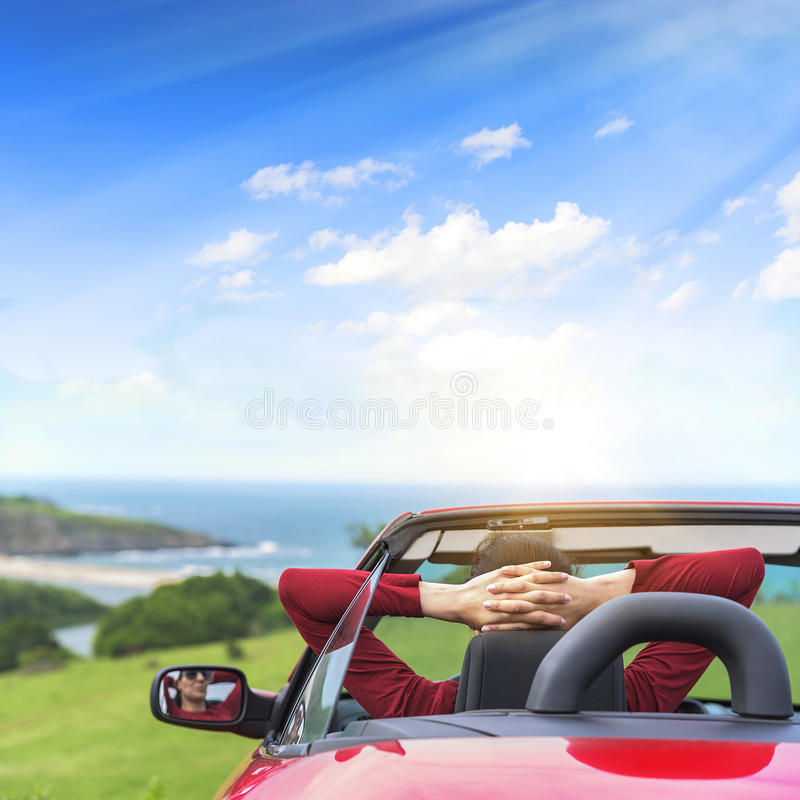 Girl in a red convertible car. stock image