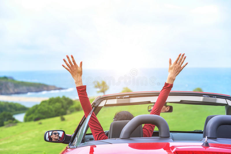 Girl in a red convertible car. royalty free stock image