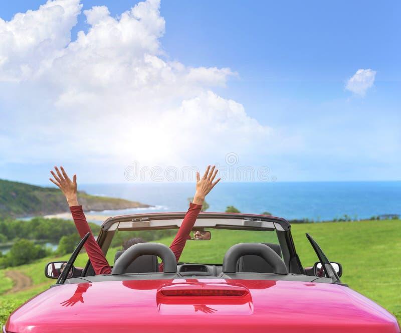 Girl in a red convertible car. stock photos
