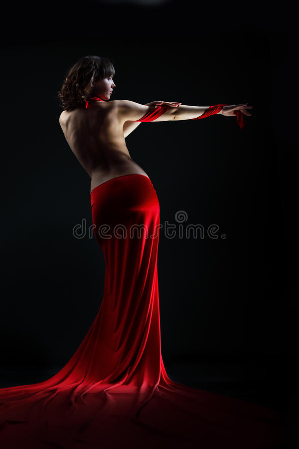 The girl in a red dress stock images