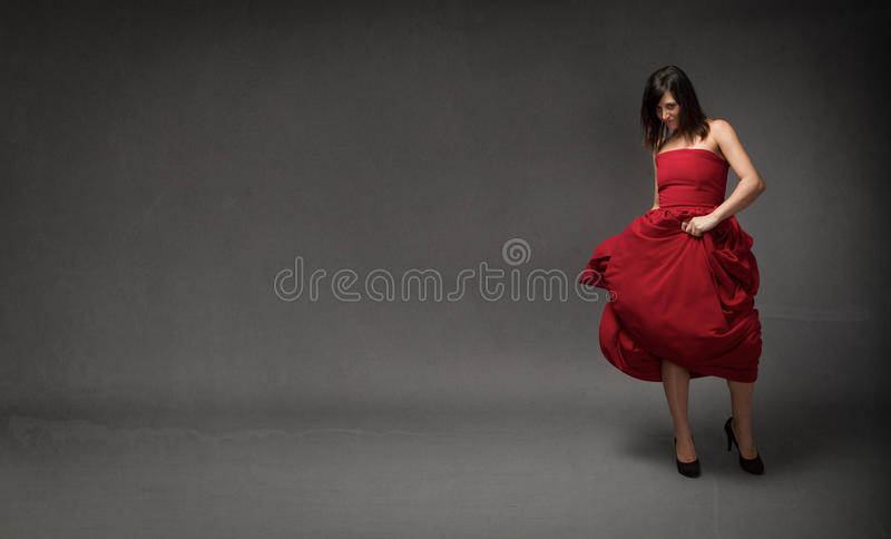 Girl in red dress. Dress stock photos