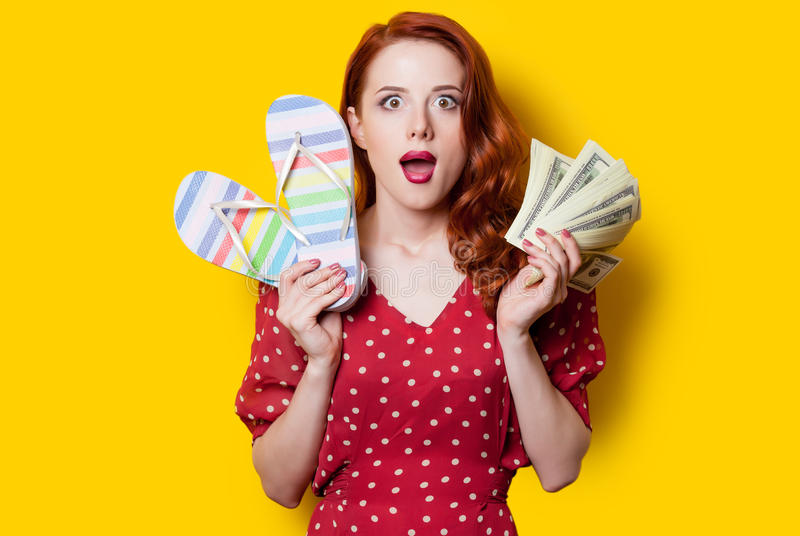Girl in red dress with flip flops and money royalty free stock photography