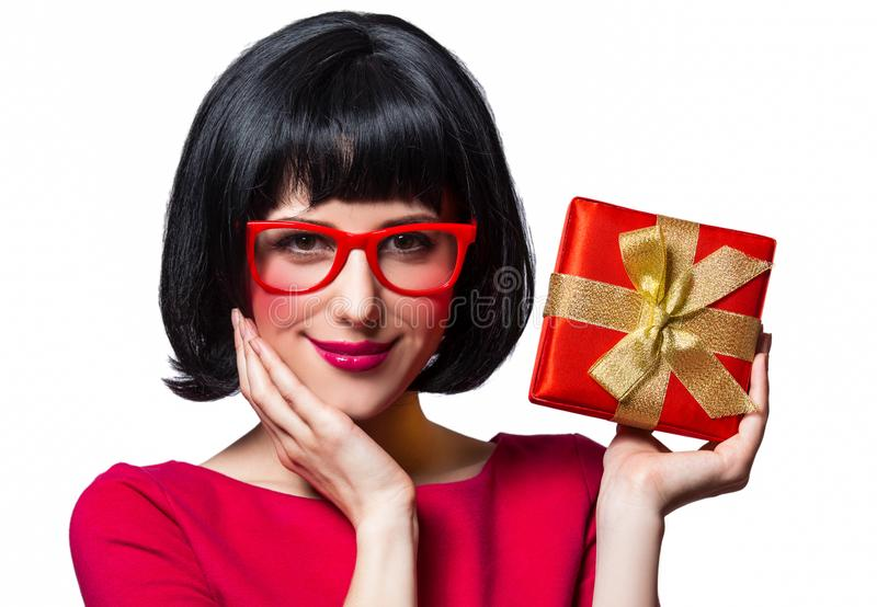 Girl in red dress and glasses with present box royalty free stock image