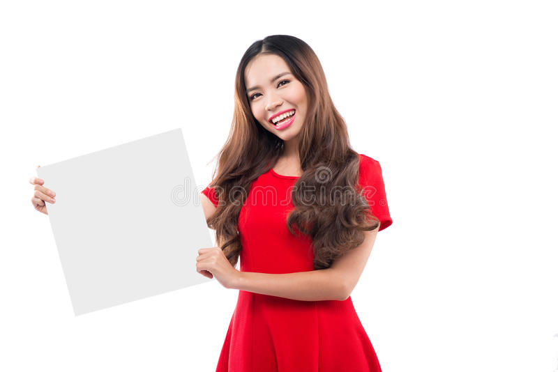 Girl in a red dress holding a piece of white paper stock photo
