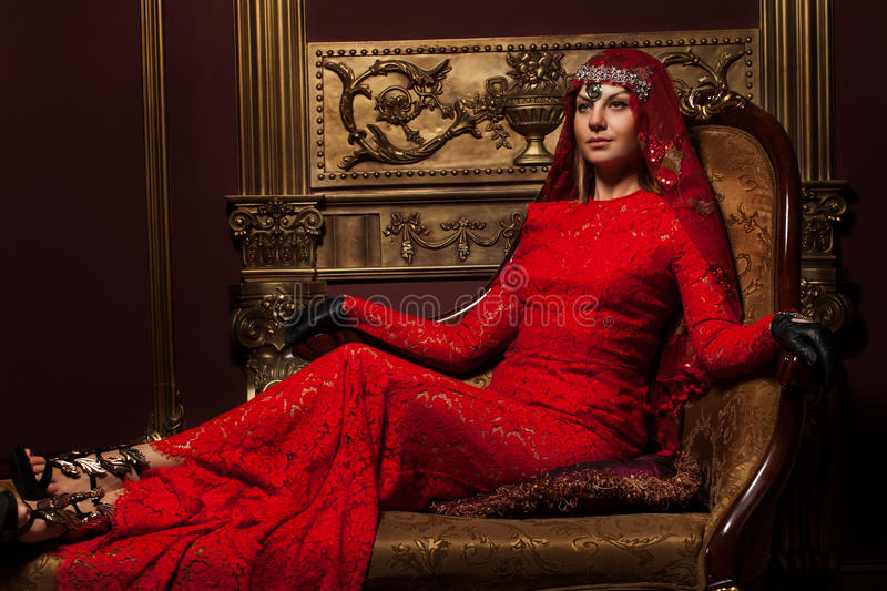 Girl in red dress in the interior royalty free stock photography