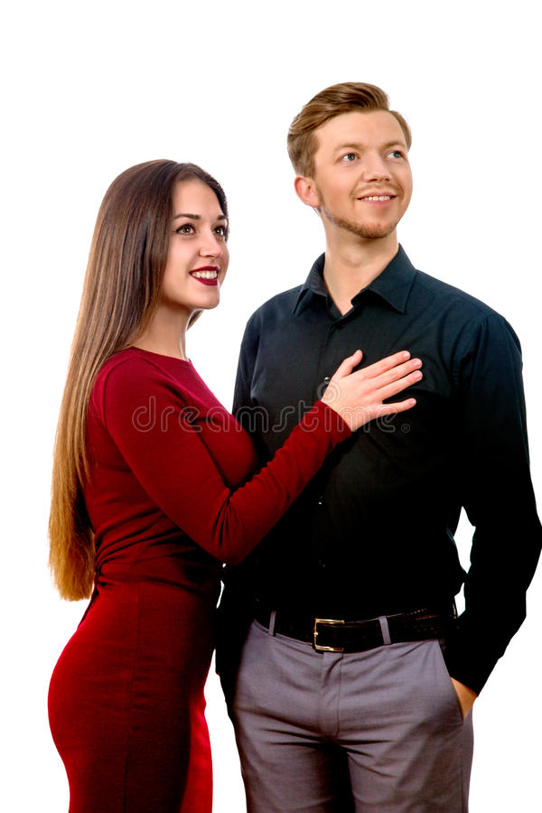 Girl in a red dress and a man in a black shirt. Image of a beautiful girl in a red dress and a men in a black shirt royalty free stock photo