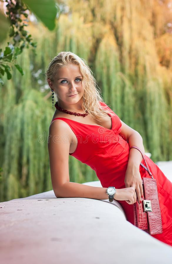 Girl in a red dress in the nature. Ukraine royalty free stock photo