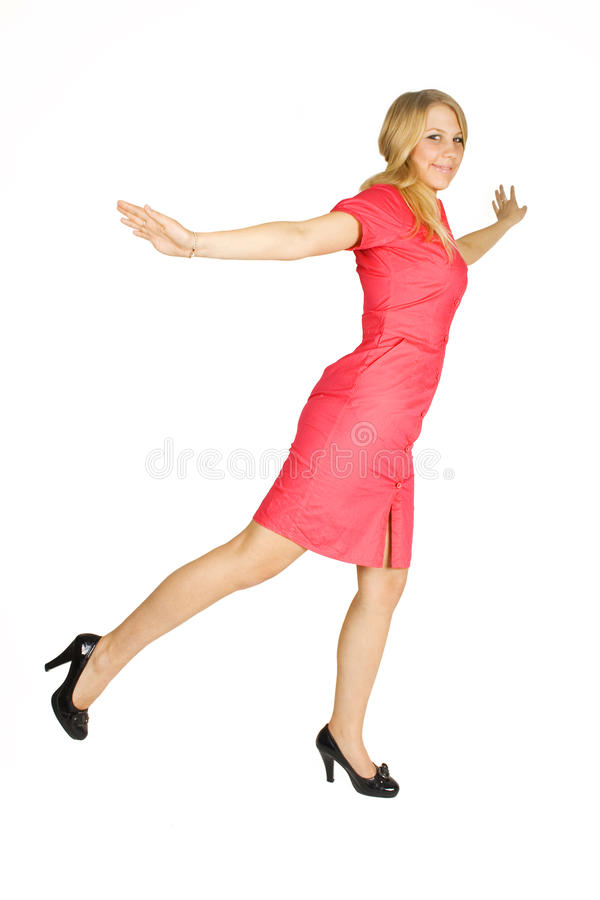 Girl in red dress standing on one leg